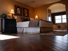 hardwood floor, blanket, bed, lamp