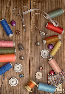 sewing notions: thread, buttons, ribbon, scissors