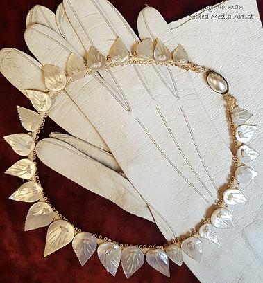 SS Story. Clara's necklace, gloves LOGO.