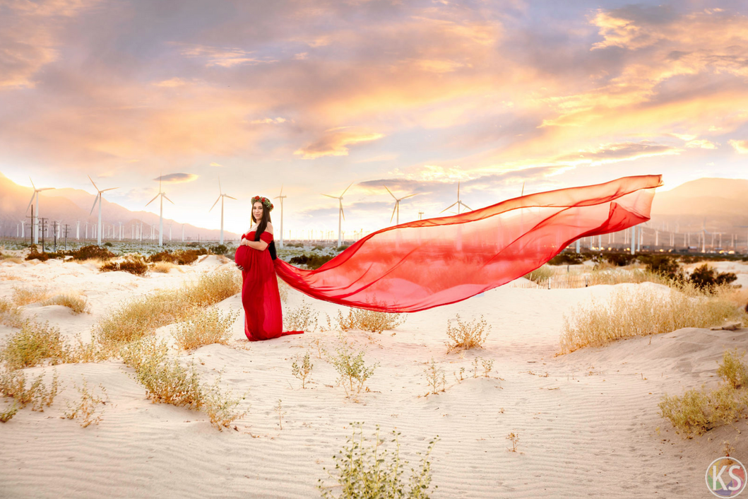 Beautiful maternity photography with flowing dress