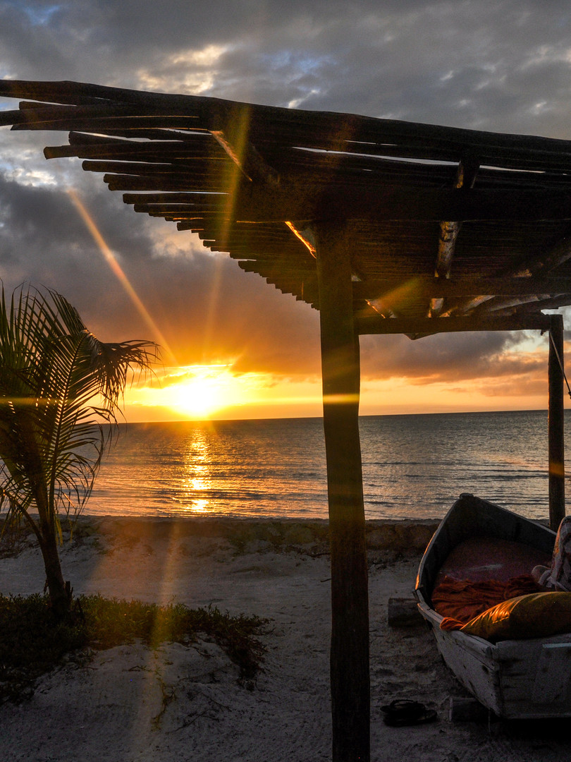 Beach sunset in a Boat Bed Canopy at Hol