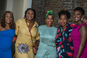 5 beautiful black women with gorgeous smiles and bright summery options appropriate for this late summer wedding.
