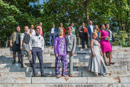 """Post ceremony officiated by queer officiant from Once Upon A Vow; two grooms from the Caribbean front and center of this fabulous shot with their 15 guests posed on the stone steps of Granite Prospect - Brooklyn Bridge ALL looking towards the camera or beyond it as if to say, """"that's right, we're a boss crew!"""""""