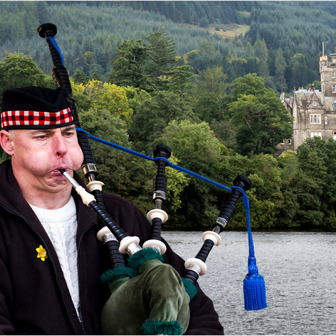 2nd - Playing the Bagpipes