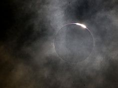 Solar Eclipse Diamond Ring through the Clouds