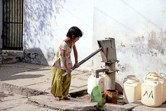 Indian girl collecting water