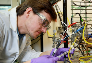 Alex Lewis, a doctoral student with the Bredesen Center for Interdisciplinary Research and Education, samples a microbial electrolysis cell to measure hydrogen and proton concentrations. (Credit: ORNL)