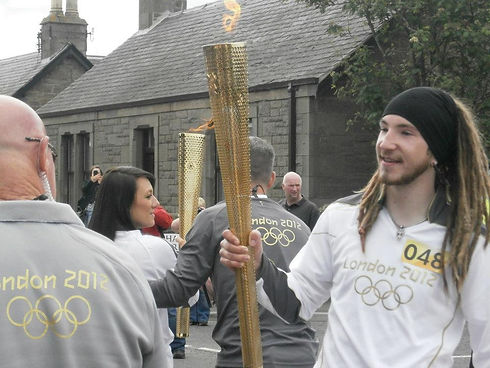 with Olympic Flame.jpg