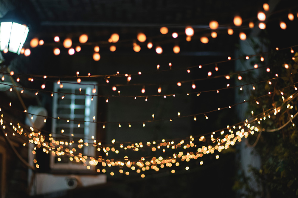 Strings of small lights at night over an outdoor scene