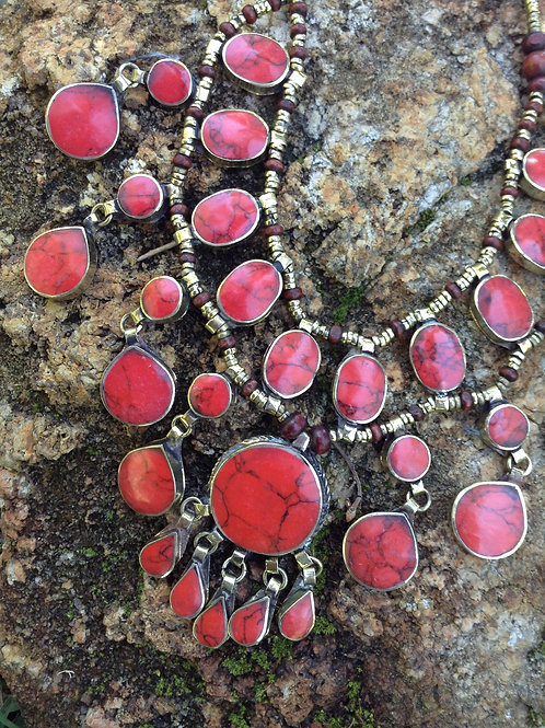 Red necklace with round focal