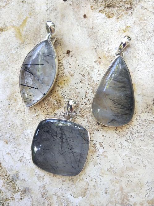 Tourmalinated quartz pendants