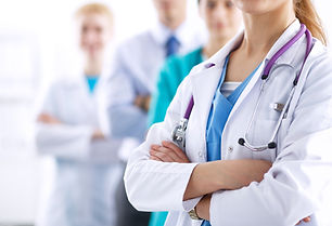 Attractive female doctor in front of med