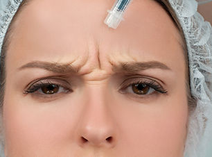 Woman is getting injection. Anti-aging t