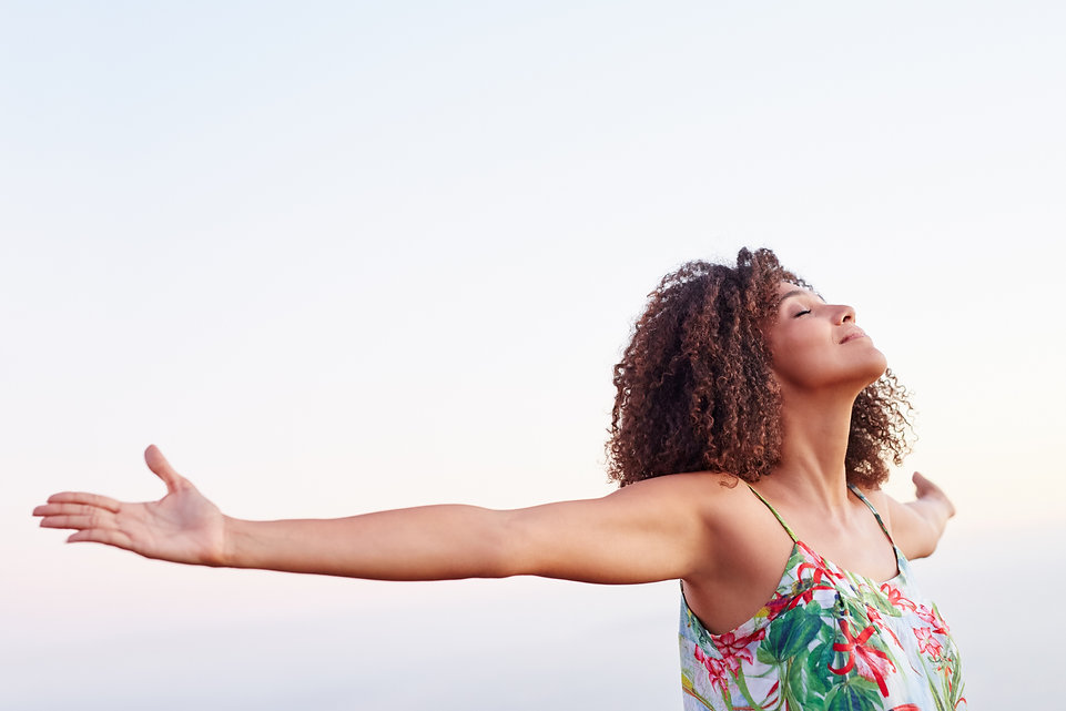 Woman outdoors with her arms outstretche