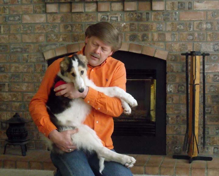 Borzoi puppy Braedon hugging Jeff