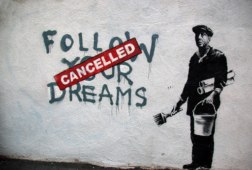 Picture says follow your dreams, with a man holding a paintbrush and a bucket. On top of follow your dreams, a red banner says cancelled. Picture taken from: