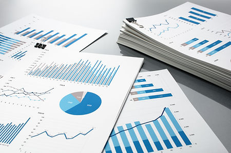 Preparing report. Blue graphs and charts