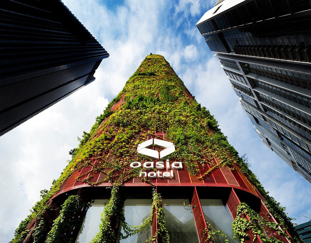 The WOHA-designed Oasia Hotel in Singapore is a prime example of sustainable architecture meeting high design. Completed in 2016, the verdant building utilizes its many gaps and porous exterior to allow natural air to funnel in and around the interiors, thus saving on energy.