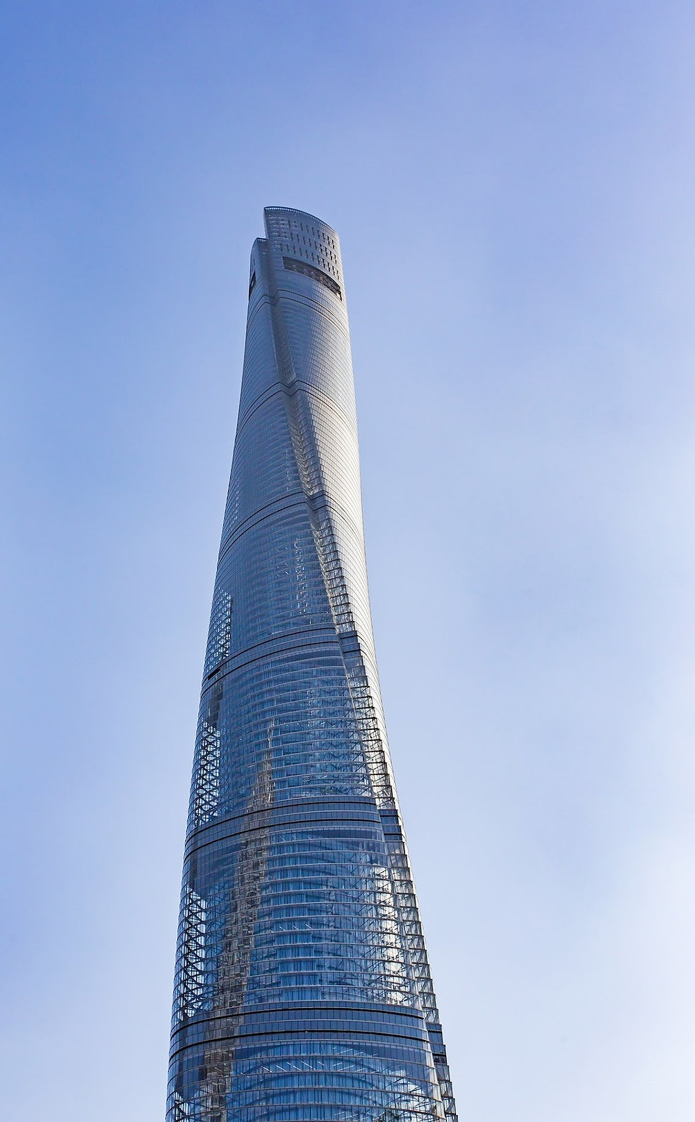 "The Gensler-designed Shanghai Tower is the second tallest building in the world (behind Dubai's Burj Khalifa). Towering 2,073 feet in the air, this skyscraper implements such advancements as a ""transparent second skin,"" which consists of a double-glass façade that significantly reduces the building's carbon footprint. A LEED Gold certified building, Shanghai Tower's exterior lighting is powered by wind-driven generators."