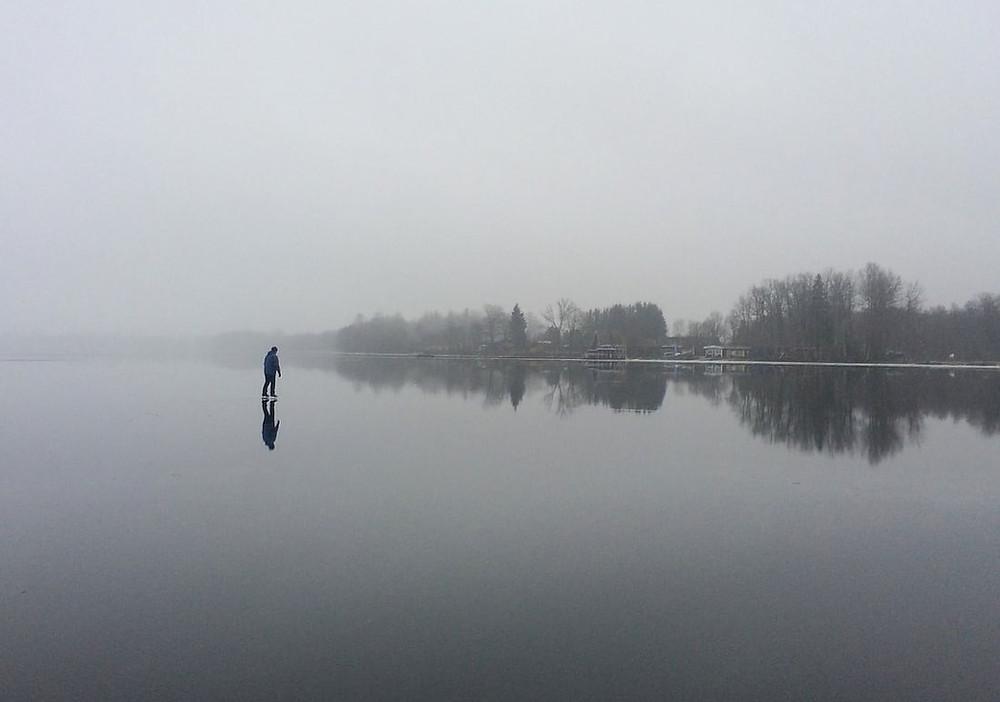 Fun winter activities skating on a lake in Haliburton