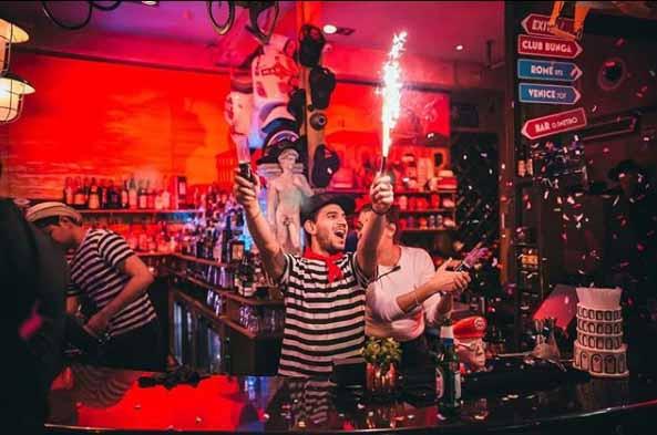 Man behind the bar with firecracker