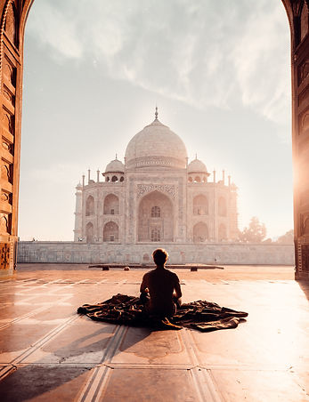 person-sitting-in-front-of-the-taj-mahal