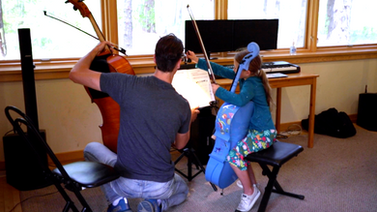 Teaching cello to a young student