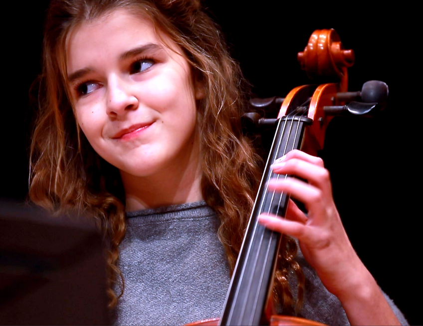 Cello student performing
