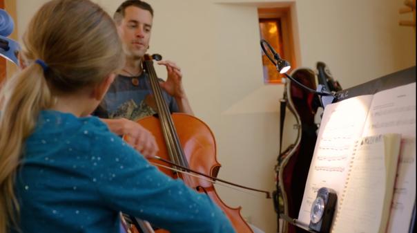 Shaun teaching a cello lesson