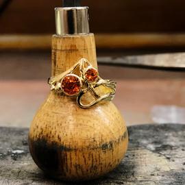 orange sapp 3 stone ring.jpg