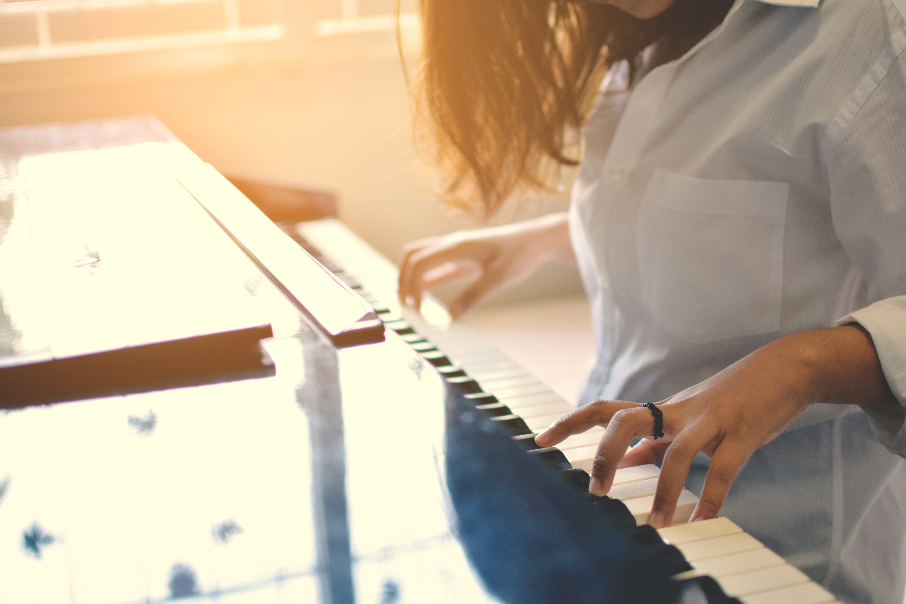 women playing piano ,selective and soft focus, vintage tone