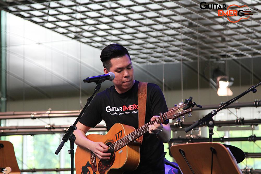 Lebbeus on acoustic guitar