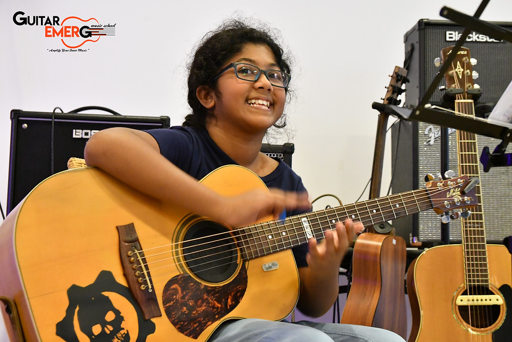 Mythili (Singer / Acoustic Guitarist)