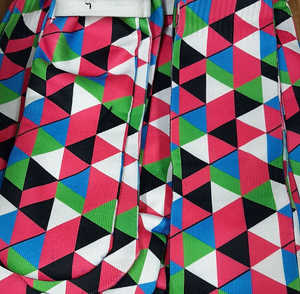 Socks with green, blue, white, pink and black geometric designs