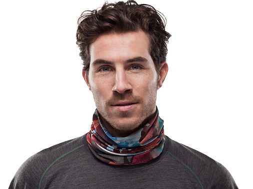 Man wearing multi-color buff around neck looking directly at camera