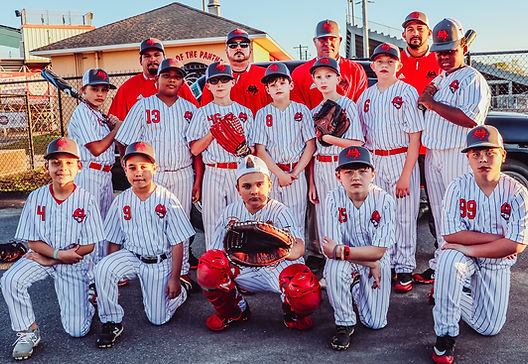 Youth baseball team portrait in full uniform