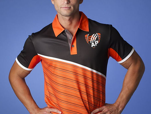 Man with hands on hits wearing custom black, white, and orange polo with company logo on the left side of the shirt just above the chest.