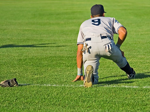 Baseball player warming up on field in full uniform