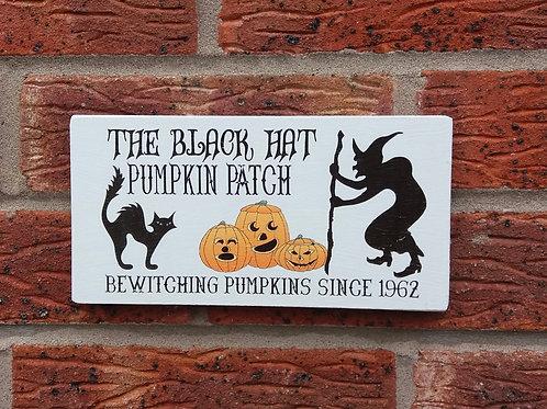 The black hat pumpkin patch plaque