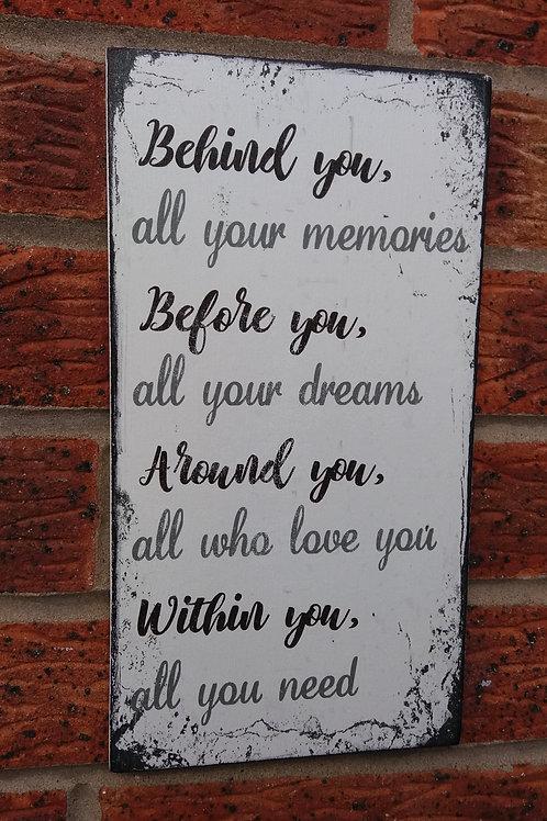 Behind you plaque