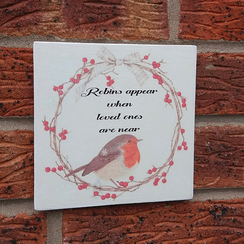 Robins appear when loved ones are near plaque