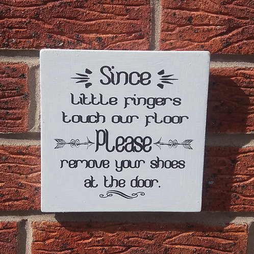Since little fingers touch our floor plaque