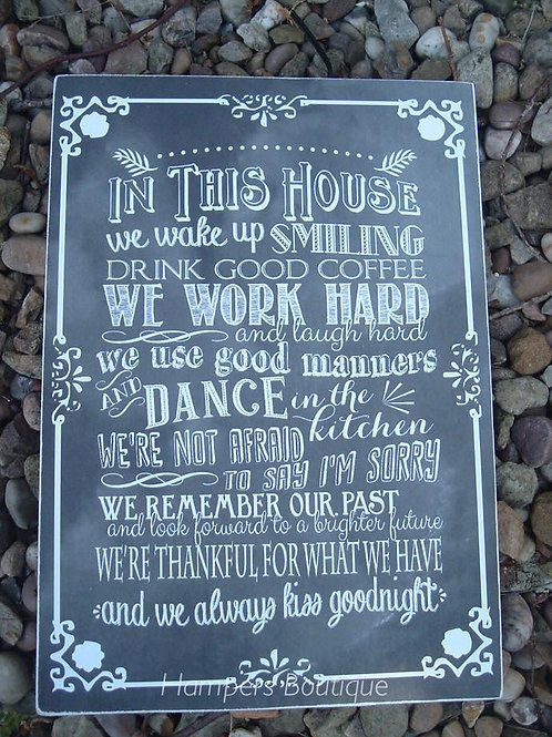 In this house we wake up smiling plaque