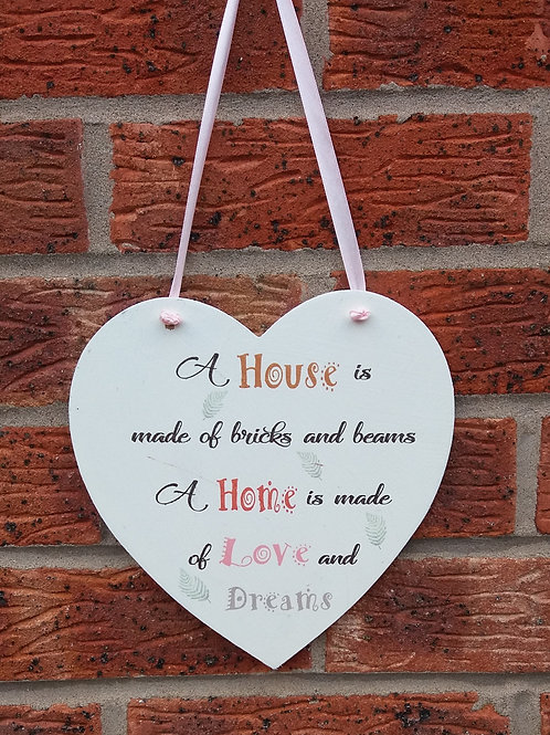 A house is made of bricks and beams hanging heart