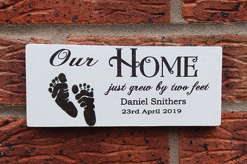 Our home just grew by two feet plaque
