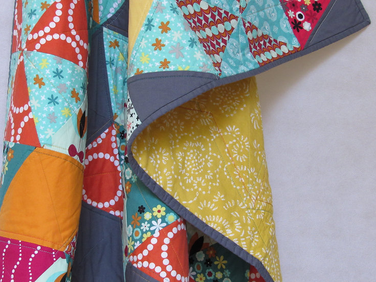 Modern quilt in magenta, turquoise, orange and grey