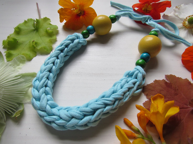 Crocheted necklace - light turquoise with yellow, blue and green wooden beads