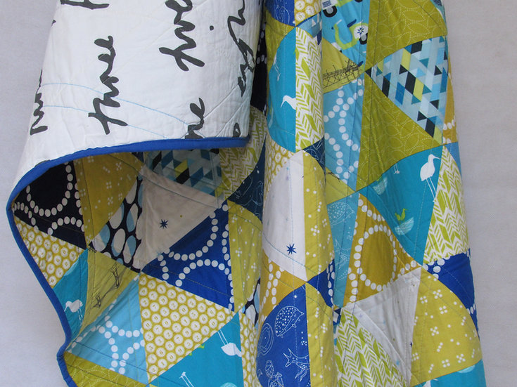 Modern patchwork quilt in shades of yellows and blues