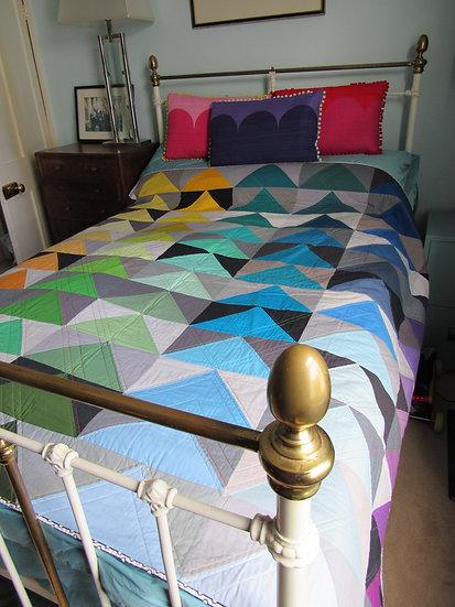 Rainbow half square triangle quilt