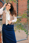 Vest, blouse and skirt from The Cute Hunter. Boots from Boot & Trunk.